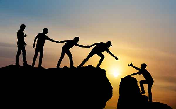 people lifting others up - make a difference